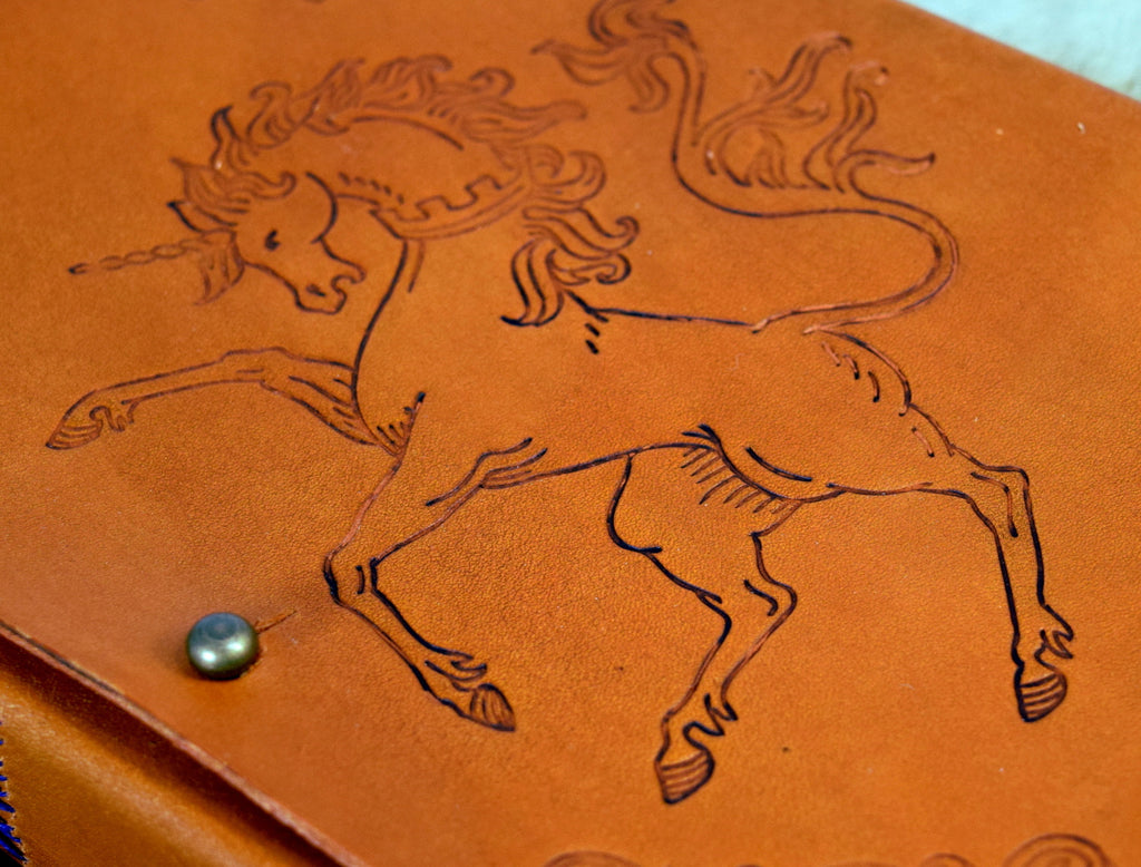 Close up of unicorn design on leather