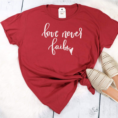 Love Never Fails Ladies Short Sleeve Shirt