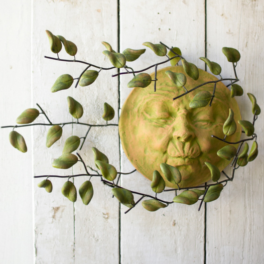 Sun Face With Blowing Leaves Wall Art