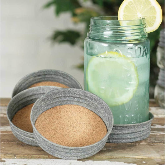 Mason Jar Lid Coaster with cork inside to absorb moisture with a barn roof finish.
