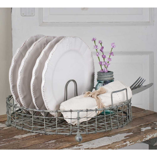 Charming Vintage Style Wire Dish Rack with rustic finish used for displaying dishes.