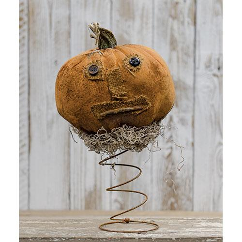 Primitive Pumpkin on a rusty spring