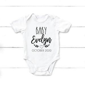 Baby announcement onesie with heart - Happyism, Inc. Engraving