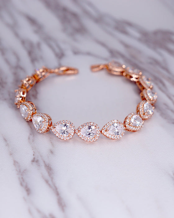 Rose Gold Halo Teardrop Ear Studs and Bracelet | Timeless Classy Wedding Jewelry