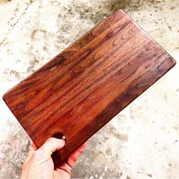 Beautifully handcrafted cutting board made with reclaimed Black Walnut. Crafted by local Ohio Valley Reclaimed maker near Cincinnati, OH.