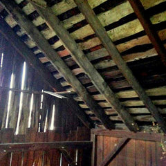 Image of the inside framework of a 100 year old barn near Cincinnati, OH where the Ohio Valley Reclaimed team has salvaged materials for reclaimed wood projects