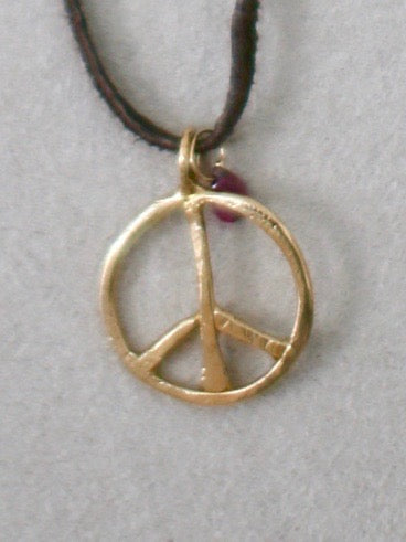 Gold peace sign