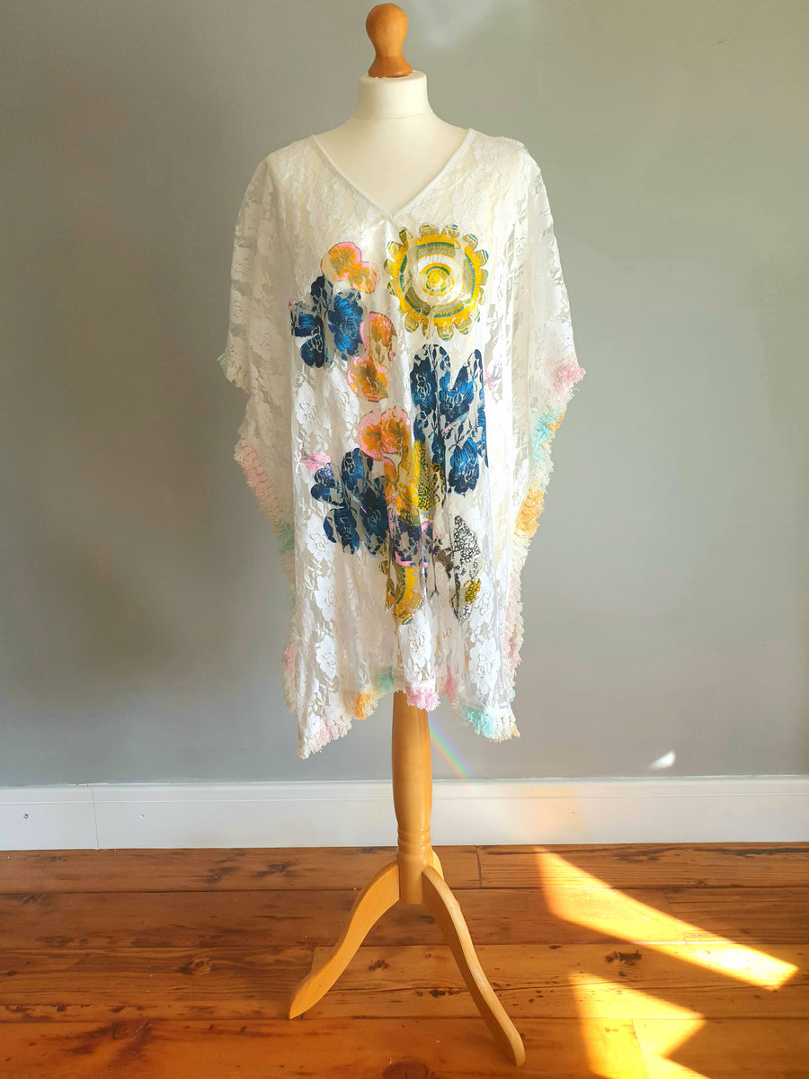 POSITANO Lace Poncho, Various colours on a white background. One size