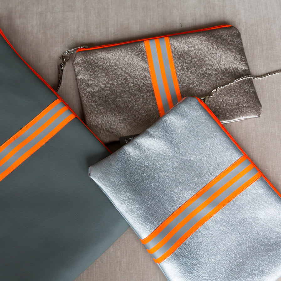fil@home make-up / clutch bag with strap  - silver with orange contrast stripes