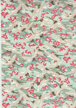 CHY1024  Yuzen Chiyogami--White and black cranes on a blue background with pink and white cherry blossoms