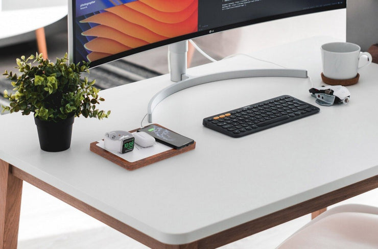 NYTSTNDTRIO, Black top, white base, desk organizer, NYTSTND charger next to the plant and  PC