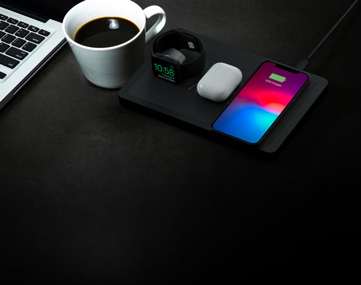 NYTSTND TRIO black leather top, black wooden base,lifestyle picture, on the desk next to the coffee cup