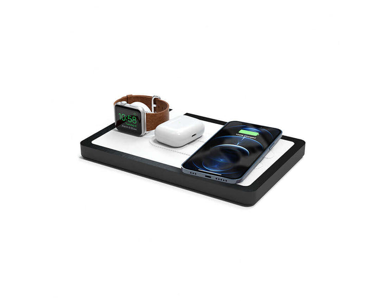 NYTSTND TRIO White leather top Black wood base, MagSafe charger, Angle view Watch, AirPods, iPhone