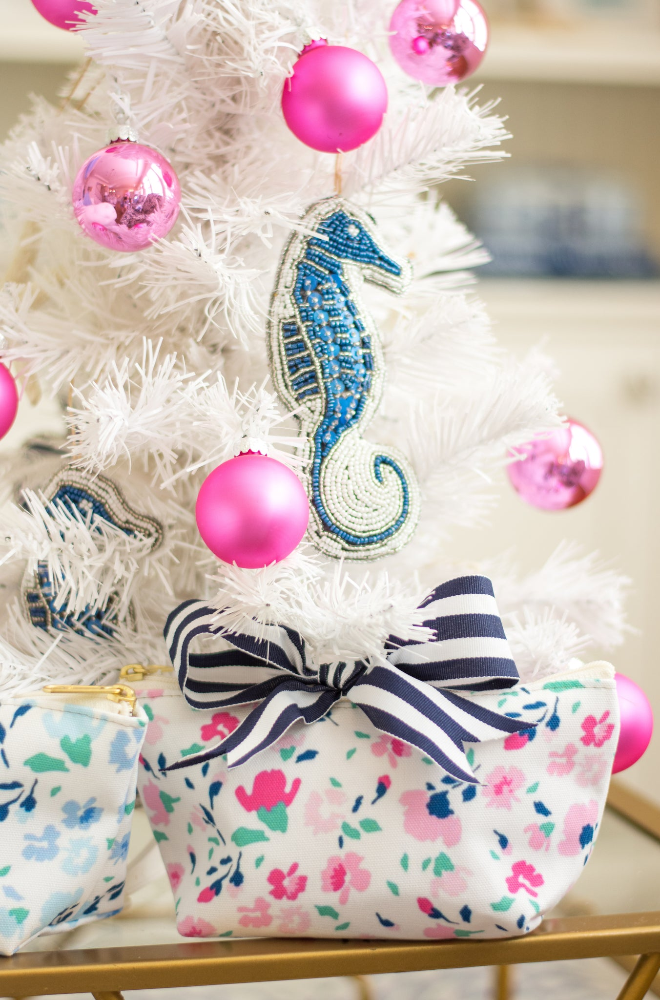 preppy white Christmas tree with pink and blue ornaments and navy striped bow