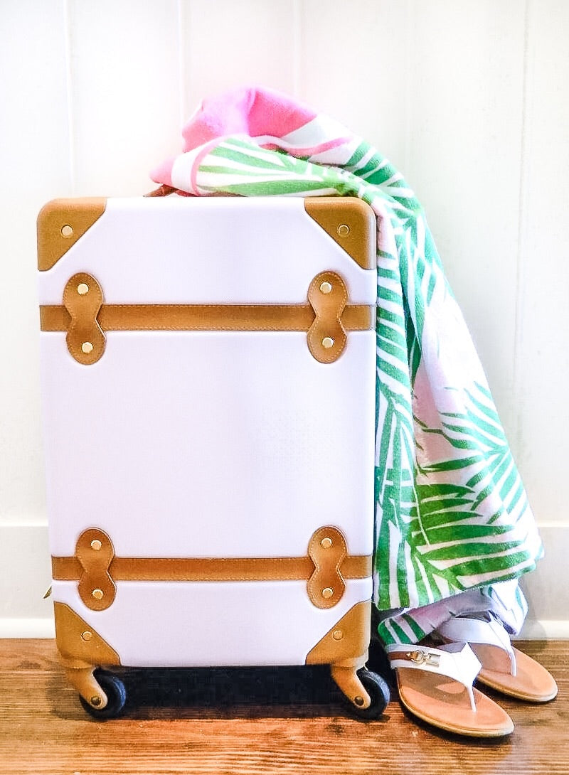 pink suitcase with personalized beach towel in preppy palm tree print