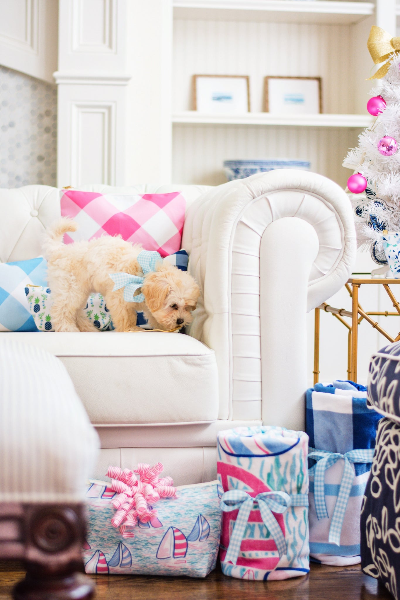 preppy gingham gifts on white chesterfield sofa