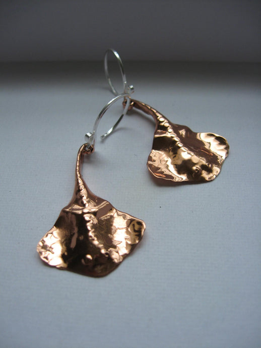 Hand forged copper stingrays on sterling wires