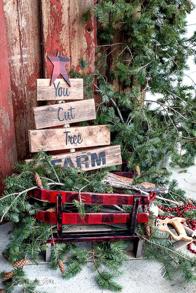 You Cut Tree pallet wood sign in a Buffalo Checked vintage sleigh for Christmas decor | stencilled with Funky Junk's Old Sign Stencils