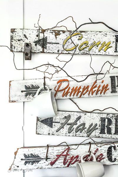 Make these fall directional signs with iconic fall sayings by Funky Junk's Old Sign Stencils! 4 to choose from: Pumpkin Patch, Apple Cider, Hay Rides and Corn Maze.