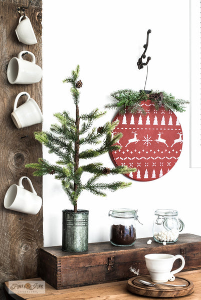 Make a Christmas sweater styled lazy susan or wood ornament from a wood round with Funky Junk's Old Sign Stencils!