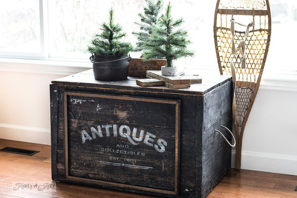 Reclaimed wood trunk enhanced with Antiques by Funky Junk's Old Sign Stencils. Celebrate your love for vintage collections, by painting your own old Antiques sign onto reclaimed wood, furniture, etc!