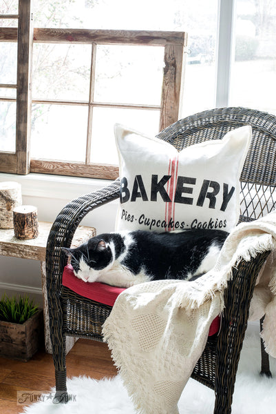 A grain sack pillow with authentic looking stenciled grain sack stripes, made with Funky Junk's Old Sign Stencils