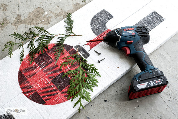 Learn how to stencil this festive JOY sign with a Buffalo Checked ornament! Made with Funky Junk's Old Sign Stencils.