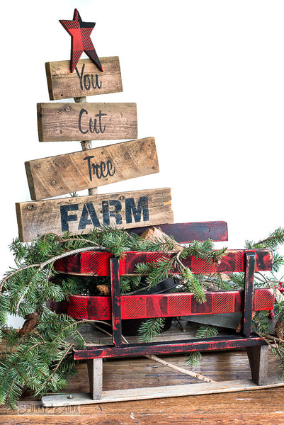 Red and black buffalo check on a vintage sleigh made with Buffalo Check stencil by Funky Junk's Old Sign Stencils