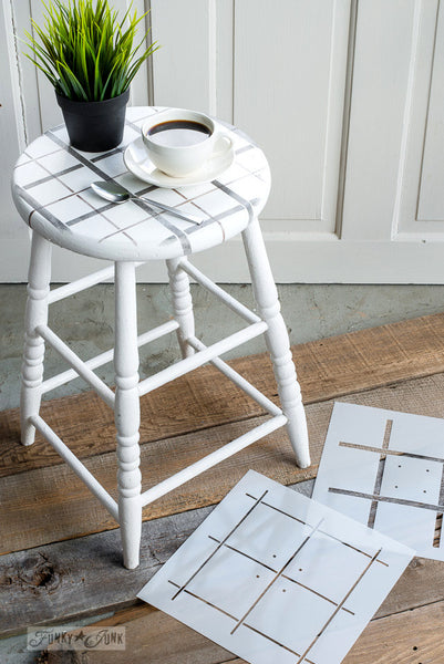 Plaid pattern stenciled on a stool with Plaid Shirt by Funky Junk's Old Sign Stencils. A 2-piece plaid stencil design that offers a realistic plaid pattern done in colours of your choice onto reclaimed wood, furniture or fabric in minutes!