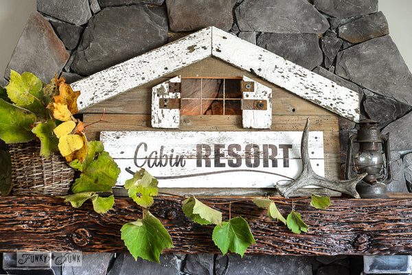 A cabin shaped Cabin Resort sign made with Funky Junk's Old Sign Stencils