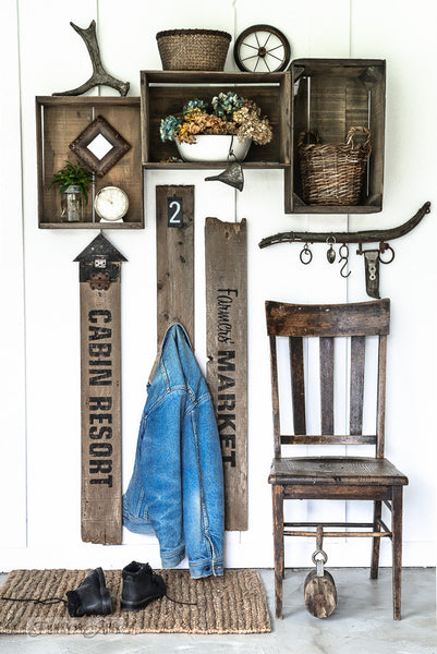 A reclaimed wood farmhouse entry coat hook area, made with Farmer's Market, a stencil by Funky Junk's Old Sign Stencils