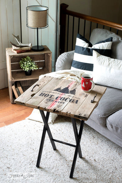 A pallet wood TV tray stenciled with Christmas Blend Hot Cocoa 5 LB Bags, a charming Christmas stencil that comes with a grain sack stripe. By Funky Junk's Old Sign Stencils