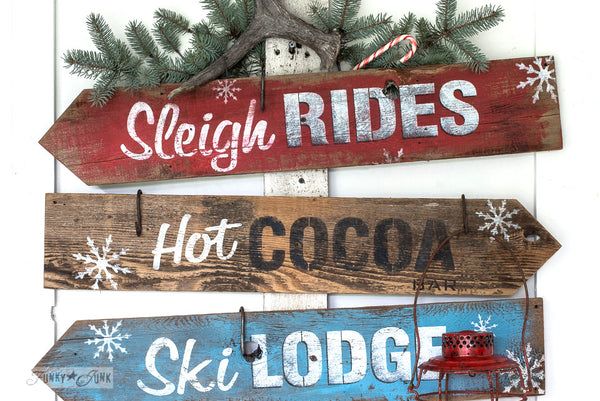 Winter directional signs made with Sleigh Rides from Funky Junk's Old Sign Stencils. Create professional painted winter themed sleigh styled signs onto reclaimed wood in minutes with this festive, wintery stencil design!