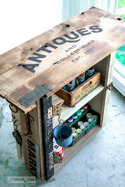 Reclaimed wood storage cupboard with Antiques by Funky Junk's Old Sign Stencils. Celebrate your love for vintage collections, by painting your own old Antiques sign onto reclaimed wood, furniture, etc!