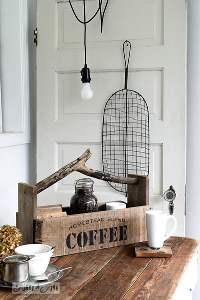 A rustic farmhouse toolbox stencilled with Homestead Blend Coffee Served Here. By Funky Junk's Old Sign Stencils