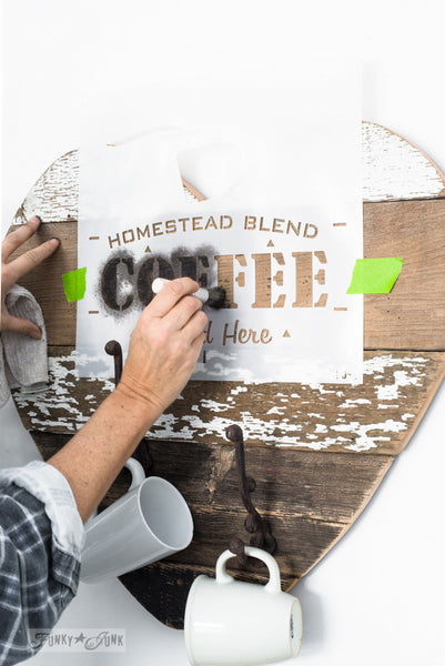 A rustic farmhouse wood heart stencilled with Homestead Blend Coffee Served Here. By Funky Junk's Old Sign Stencils