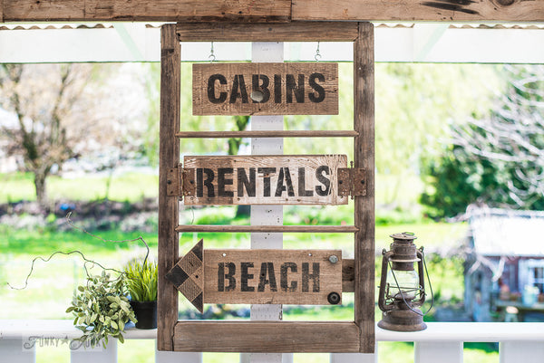Old window cabin, rentals and beach directional vacation signs made with the Getaway Collection from Funky Junk's Old Sign Stencils