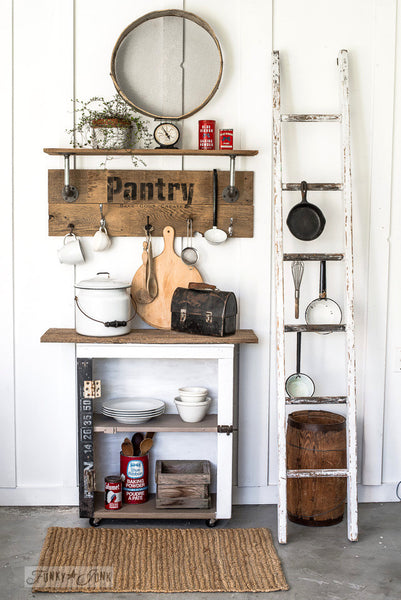 Reclaimed wood and pipe shelf made with Pantry by Funky Junk's Old Sign Stencils. Paint professional looking vintage farmhouse styled pantry signs onto reclaimed wood with a stencil in minutes!