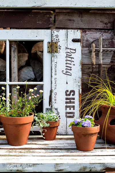 Potting Shed shutters on a shed with Funky Junk's Old Sign Stencils. Paint professional looking vintage farmhouse styled garden signs onto reclaimed wood with a stencil in minutes!