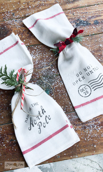 Learn how to make these adorable festive napkins from Ikea tea towels! Made with Christmas Crates by Funky Junk's Old Sign Stencils.