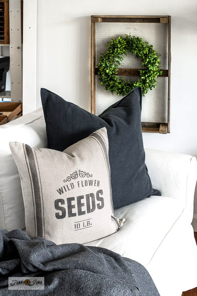Learn how to stencil this vintage-inspired Wild Flower Seeds grain sack pillow with an Ikea pillow cover! Showcasing Wild Flower Seeds and Grain Sack Stripe GL4 from Funky Junk's Old Sign Stencils.