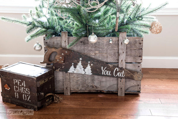 You Cut Tree Farm saw sign made with Funky Junk's Old Sign Stencils. Paint professional looking Christmas tree signs onto reclaimed wood in minutes with this festive stencil! Christmas tree graphic is included.
