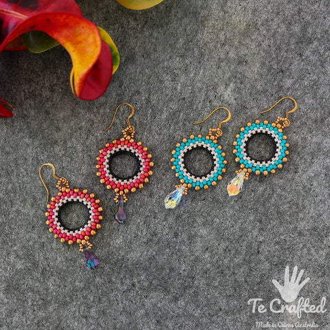 Beaded circular drop earrings