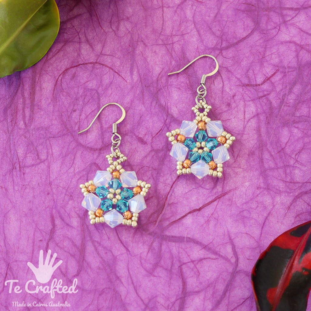 Beaded pentagon earrings light blue
