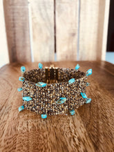 BROWN CUFF WITH TURQUOISE STONE PENDANTS