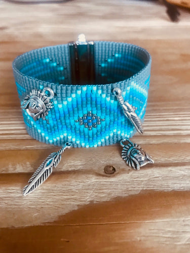 TURQUOISE AND GREY CUFF WITH METAL FEATHER AND HEADDRESS CHARMS