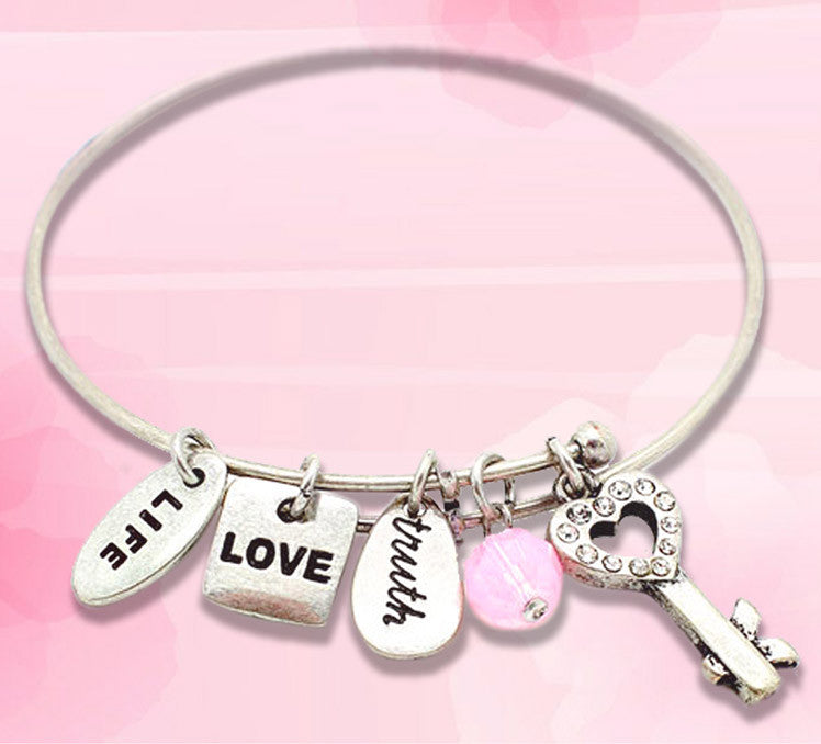 Open the door to eternal love with heart key charm bracelet