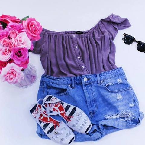 denim cutoffs, purple top, white jelly sandals, sunglasses, flowers