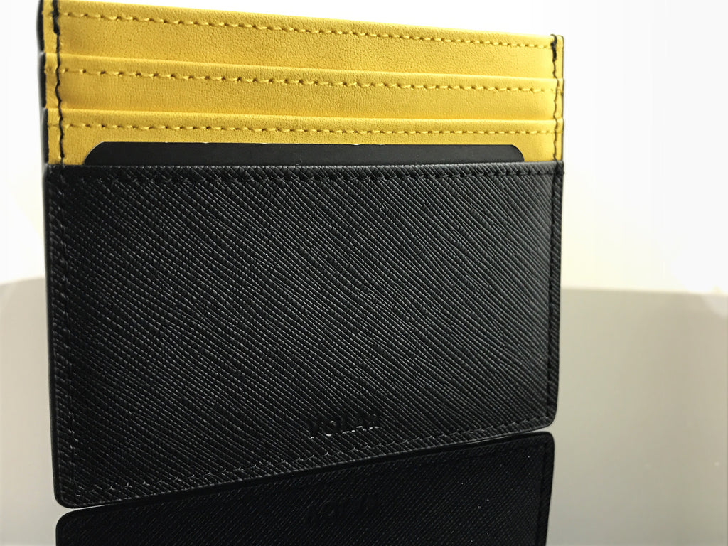 Giallo Modena Yellow cardholder and keychain by Volar blends in perfectly with any casual or business outfit.