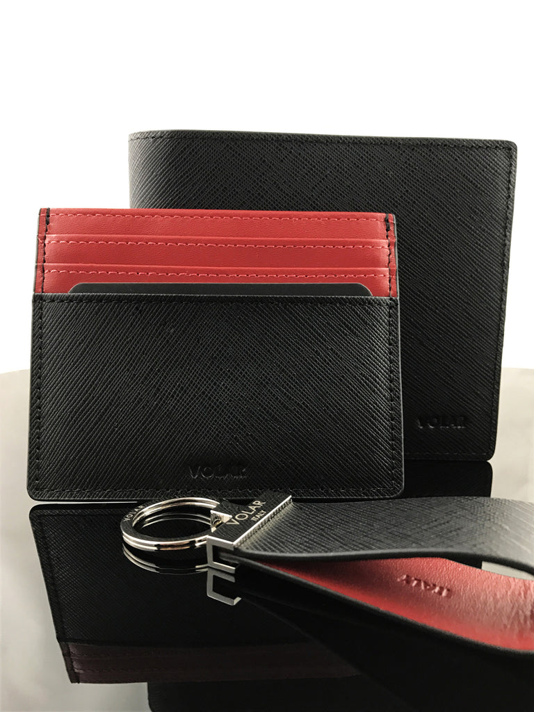This Rosso Corsa Bi-fold wallet accentuates its elegance with leather details and stitching.